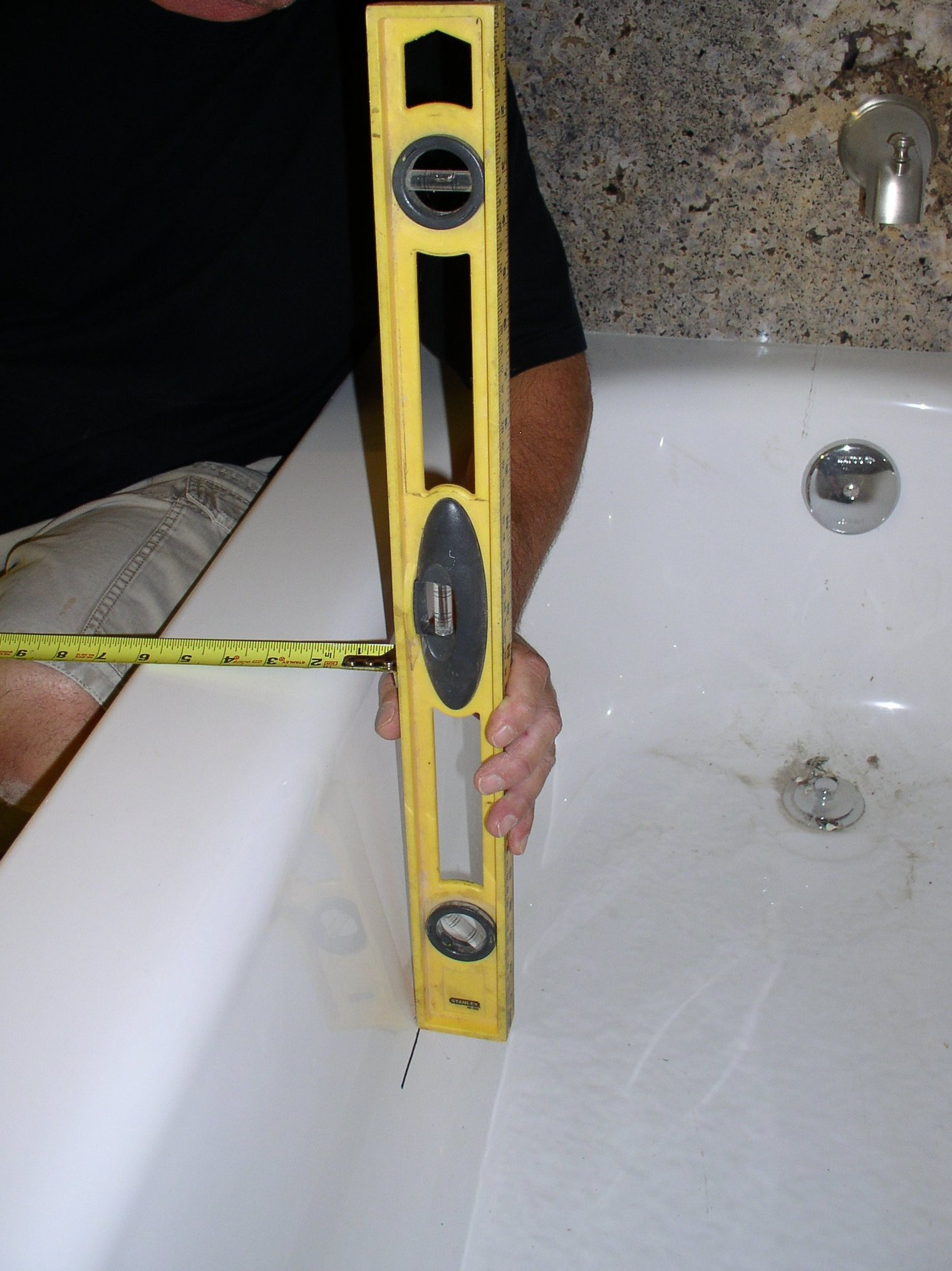 Image depicting the key measurement for determining the correct tub to shower conversion kit for a tub