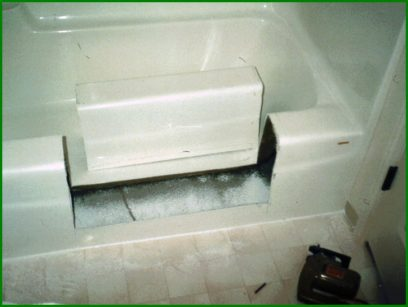 Image shows a tub cut and ready for tub to shower conversion completed with a tub to shower kit